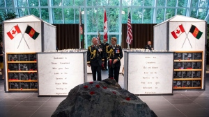 Governor General Julie Payette and Chief of the Defence Staff Jonathan Vance walk through the Afghanistan Memorial Hall following the rededication ceremony of the Kandahar cenotaph at National Defence Headquarters in Ottawa on Saturday, Aug. 17, 2019. THE CANADIAN PRESS/Justin Tang