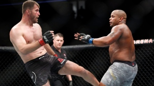 (File photo) Stipe Miocic kicks Daniel Cormier during a heavyweight title mixed martial arts bout at UFC 226, Saturday, July 7, 2018, in Las Vegas. (AP Photo/John Locher)