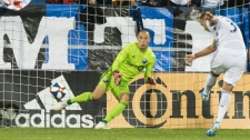 Montreal Impact's goalkeeper Evan Bush is scored on by FC Dallas' Reto Ziegler during second half MLS soccer action in Montreal, Saturday, August 17, 2019. THE CANADIAN PRESS/Graham Hughes