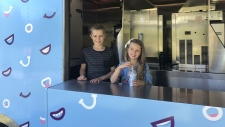 Haylen Astalos, left, is seen inside a McFlurry truck with his sister, seven-year-old Farah. Haylen has been collecting funds for the Ronald McDonald House Alberta for the past three years.