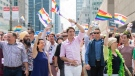 Prime Minister Justin Trudeau, centre, attends the annual pride parade with, from left, Quebec Premier Francois Legault, NDP leader Jagmeet Singh, Montreal Mayor Valerie Plante and Green Party leader Elizabeth May in Montreal, Sunday, August 18, 2019. THE CANADIAN PRESS/Graham Hughes