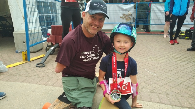 Chris Koch longboarded the Servus Edmonton Marathon 2019 on Sunday, then crossed the five-kilometre finish line with six-year-old Milania Cadrain, who skateboarded the race.