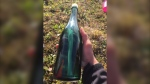 This undated photo provided by Tyler Ivanoff shows a bottle with a message that he found on the shores of western Alaska. (Tyler Ivanoff via AP)