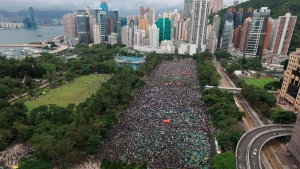 Protesters gather during a rally at Victoria Park in Hong Kong on Sunday, Aug. 18, 2019. Thousands of people streamed into a park in central Hong Kong on Sunday for what organizers hope will be a peaceful demonstration for democracy in the semi-autonomous Chinese territory. (Apple Daily via AP)