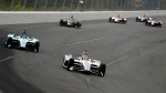 Will Power (12) drives into Turn 1 during an IndyCar Series auto race at Pocono Raceway, Sunday, Aug. 18, 2019, in Long Pond, Pa. (AP Photo/Matt Slocum)