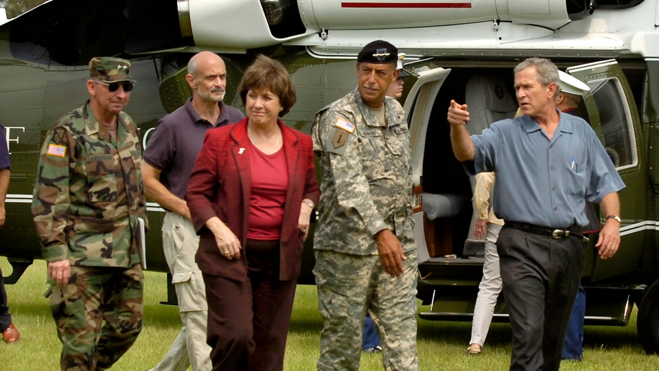 FILE- In this Sept. 5, 2005 file photo. President Bush, right, accompanied by Louisiana Gov. Kathleen Blanco, arrives in Baton Rouge, La., for a briefing at the state Office of Emergency Preparedness, following the devastation caused by Hurricane Katrina. (Patrick Dennis/The Advocate via AP, Pool, File)