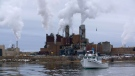"A boat and the Northern Pulp mill in Nova Scotia are shown in a still from the documentary ""The Mill.""  (THE CANADIAN PRESS/HO)"