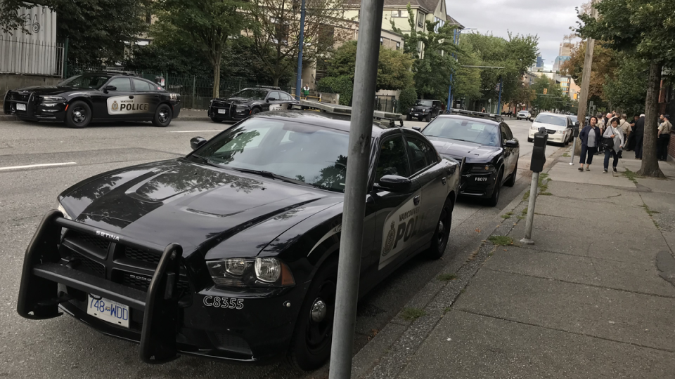 Police cruisers are parked outside of Oppenheimer Park in Vancouver on Monday, Aug. 19, 2019. (Jim Fong / CTV News Vancouver)