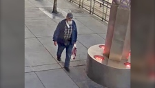 Police released this image of a man believed responsible for defacing the trans and pride flag crosswalks on Stephen Avenue on Aug. 18. (City of Calgary)