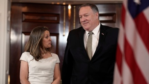 FILE - U.S. Secretary of State Mike Pompeo, right, arrives with Canadian Foreign Minister Chrystia Freeland on Wednesday, June 12, 2019, at the Department of State in Washington. (AP Photo/Sait Serkan Gurbuz)