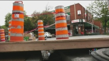 A store owner says a footbridge over the sidewalk under construction outside his shop is not safe.