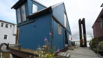 A float home on the Fraser River off West River Road in Delta is shown. (Realtor.ca)