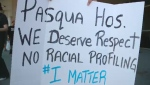 A group of approximately 20 people protested outside the front entrance of the Pasqua Hospital.