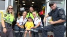 A four-year-old boy is surprised by first responders as he raised money for SickKids using a lemonade stand. (Colin Williamson/CTV News Toronto)