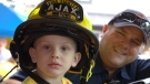 Sam Cargill is seen in a firetruck after first responders surprised him at a lemonade stand in Ajax. (Colin Williamson/CTV News Toronto)
