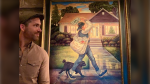 Ryan Reynolds standing proudly by his new oil painting, created by Danny Galieote. Source: Instagram.com/VancityReynolds