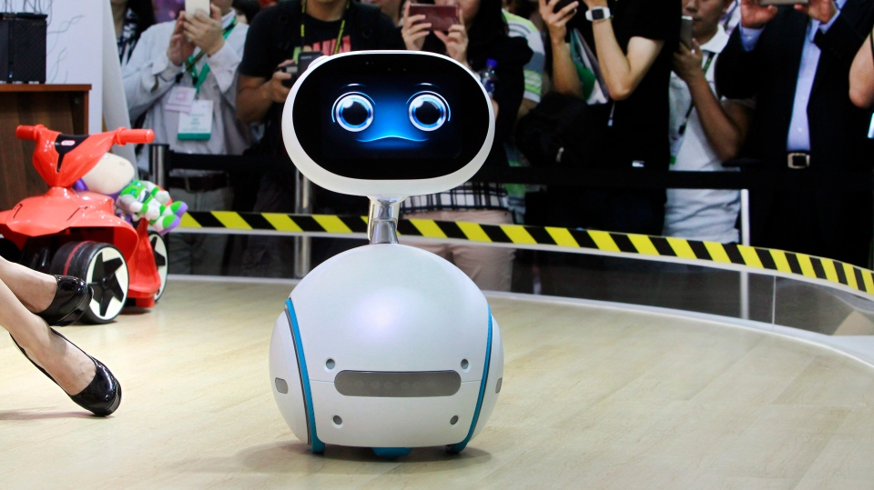 Zenbo robot from Asus performs for visitors during the Computex Taipei exhibition at the world trade center in Taipei, Taiwan, Tuesday, May 31, 2016. (AP Photo/Chiang Ying-ying)