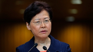 Hong Kong Chief Executive Carrie Lam listens to reporters' questions at a press conference in Hong Kong Tuesday, Aug. 20, 2019. (AP Photo/Vincent Yu)
