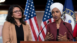 FILE - In this July 15, 2019, file photo, U.S. Rep. Ilhan Omar, D-Minn, right, speaks, as U.S. Rep. Rashida Tlaib, D-Mich. listens, during a news conference at the Capitol in Washington. (AP Photo/J. Scott Applewhite, File)