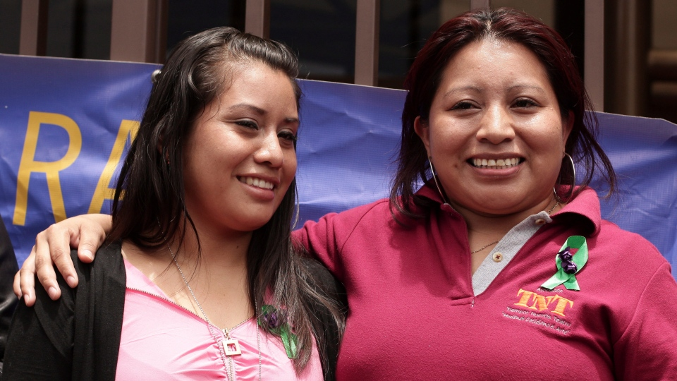 Evelyn Hernandez, left, who was acquitted on charges of aggravated homicide in her retrial related to the loss of a pregnancy in 2016, stands with Teodora Vasquez, who was convicted and imprisoned for 10 years in a similar case before her sentence was eventually commuted. (AP Photo/Salvador Melendez)