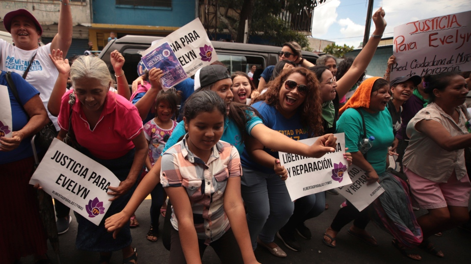 Women and girls celebrate outside court where Evelyn Hernandez was acquitted on charges of aggravated homicide in her retrial related to the loss of a pregnancy in 2016, in Ciudad Delgado, El Salvador, Monday, Aug. 19, 2019.  (AP Photo/Salvador Melendez)