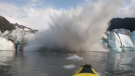 Kayakers are lucky to be alive after a glacier collapsed metres away, creating a huge wave of water and ice in a split second.