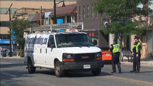 Police take photos of a truck near the intersection of Jane Street and Bloor Street in Toronto's west on August 20. (CTV News Toronto)