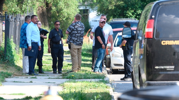 Detroit police respond to the scene where three dogs attacked a young girl who later died of her injuries in Detroit on Monday, Aug. 19, 2019. (Max Ortiz/Detroit News via AP)