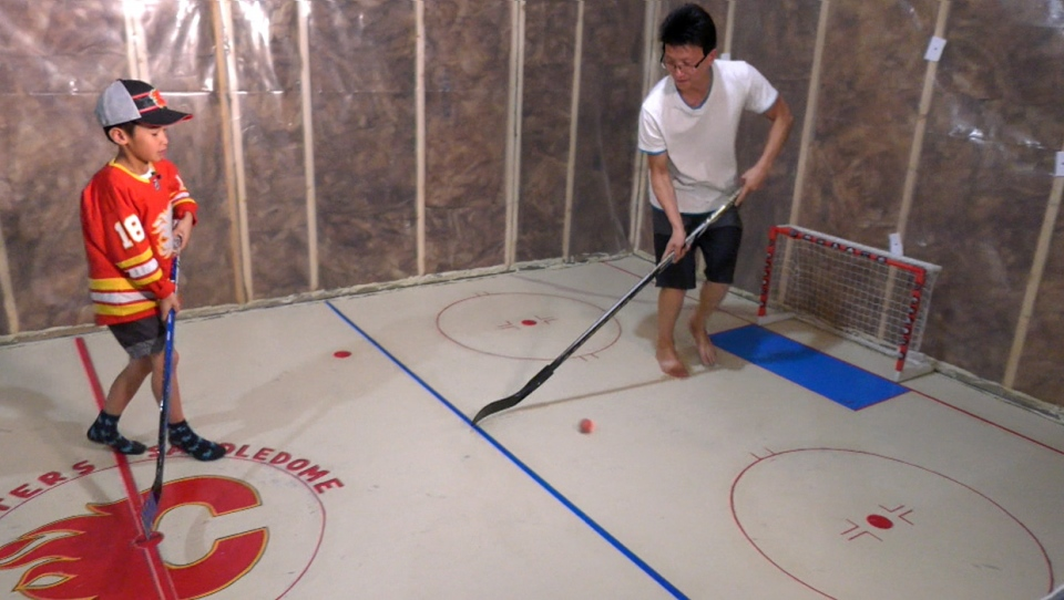 Mike and Teiden Hoang on the 'ice' of Taters' Saddledome in their northeast home