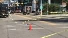 Police tape and evidence markers along 4th St SW after a truck struck a senior Tuesday morning