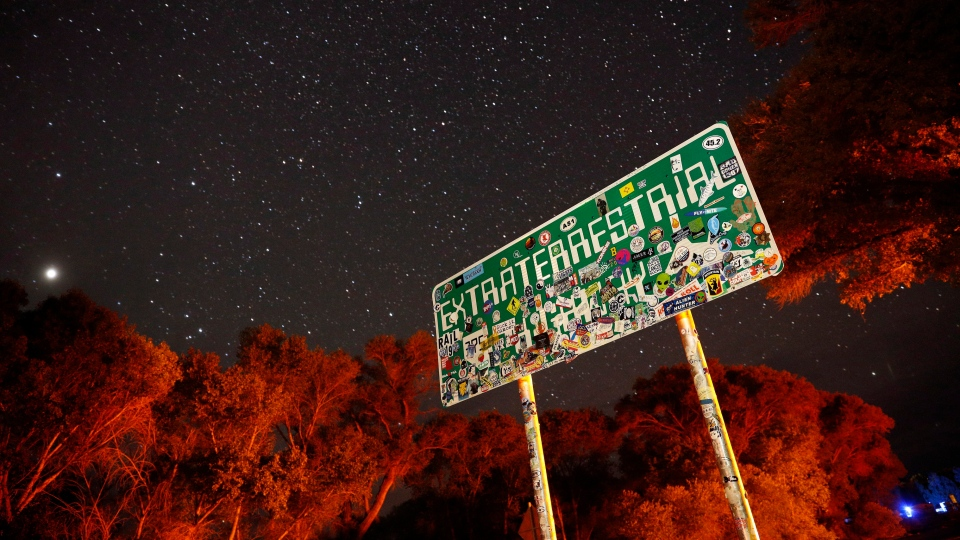 In this July 22, 2019 file photo, a sign advertises state route 375 as the Extraterrestrial Highway, in Crystal Springs, Nev., on the way to Nevada Test and Training Range near Area 51. (AP Photo/John Locher, File)