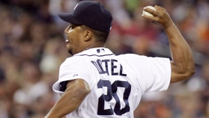 Octavio Dotel delivers against the Los Angeles Angels in the seventh inning of a baseball game Saturday, Aug. 25, 2012, in Detroit. (AP Photo/Duane Burleson)