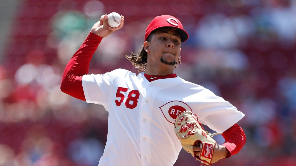 Luis Castillo throws against the Chicago Cubs during the first inning of a baseball game, Sunday, Aug. 11, 2019, in Cincinnati. (AP Photo/Gary Landers)