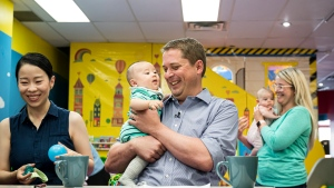 Federal Conservative leader Andrew Sheer holds 4-month old Antonio Wang while caregiver Anna Yang watches at a child care facility where he gave an announcement, in Toronto, on Tuesday, August 20, 2019. Conservative Leader Andrew Scheer is promising to provide a tax credit for new parents receiving federal benefits.Scheer is reviving an idea he first unveiled in early 2018 as a carrot for families in this fall's election. THE CANADIAN PRESS/Christopher Katsarov