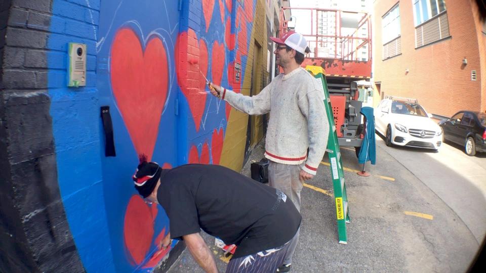 Artists working in an alley in the Beltline neighbourhood.