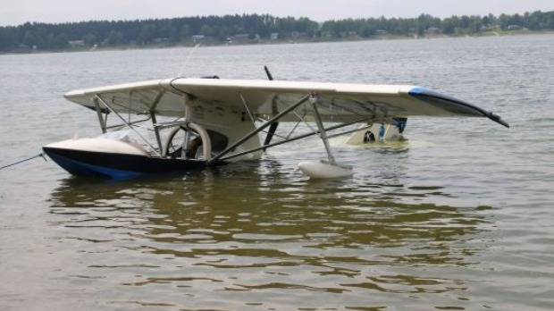 A plane being pulled out of the water