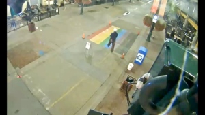 Police have charged a man with mischief relating to a pride crosswalk being vandalized and are still working to track down a suspect believed responsible for a second, similar incident.