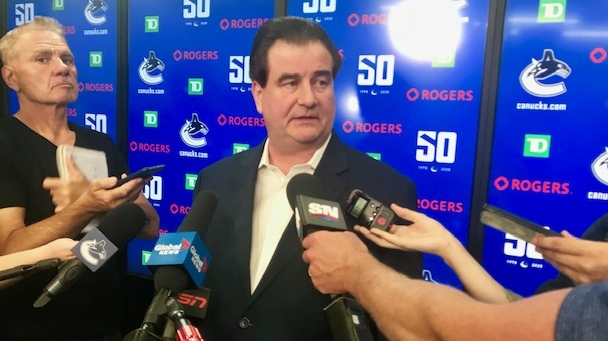 Vancouver Canucks general manager Jim Benning speaks to reporters after being re-signed for another three years with the team.