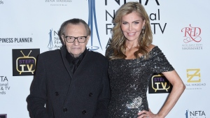 FILE - In this Dec. 5, 2018 file photo Larry King, left, and Shawn King attend the 2018 National Film & Television Awards at the Globe Theatre in Los Angeles. (Photo by Richard Shotwell/Invision/AP)