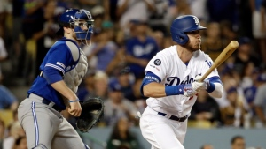 Los Angeles Dodgers' Cody Bellinger watches his three-run double against the Toronto Blue Jays during the fourth inning of a baseball game Tuesday, Aug. 20, 2019, in Los Angeles. (AP Photo/Marcio Jose Sanchez)