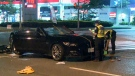 Police inspect a vehicle after a pedestrian was fatally struck in North York on Tuesday. (CTV News Toronto)