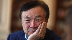 In this Aug. 20, 2019, photo, Huawei's founder and CEO Ren Zhengfei pauses during conversation with colleagues at the Huawei campus in Shenzhen in Southern China's Guangdong province.  (AP Photo/Ng Han Guan)