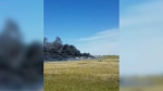 Thick black smoke is seen from a fatal multi-vehicle crash in Alberta. (Credit: Linda Nothing)