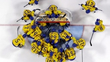 In this Feb. 2, 2018, file photo, players from Sweden gather before the preliminary round of the women's hockey game against the combined Koreas at the 2018 Winter Olympics in Gangneung, South Korea. (AP Photo/Kiichiro Sato, File)