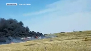 Dark smoke pours from the scene of Tuesday afternoon's fatal crash on Highway 9 near Cereal (Linda Nothing)