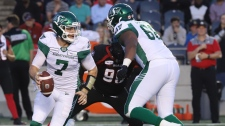 Saskatchewan Roughriders quarterback Cody Fajardo (7) runs with the ball against the Ottawa Redblacks during CFL football action in Ottawa Thursday, June 20, 2019. He's got the hot hand right now, but Fajardo says there's no quarterback controversy with the Saskatchewan Roughriders. In Fajardo's mind, once incumbent Zach Collaros comes off the injured list, the starting job is Collaros's to reclaim. THE CANADIAN PRESS/Fred Chartrand