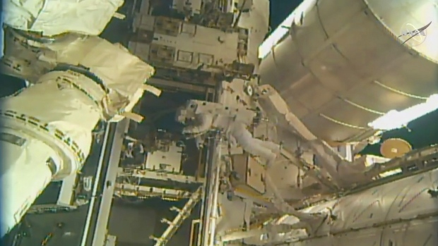 Astronauts Spacewalk, Install New Docking Port Outside Space Station