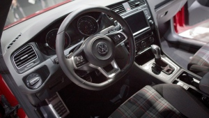 The 2014 Volkswagen Golf GTI is unveiled during the 2013 New York International Auto Show at the Jacob K. Javits Convention Center, Wednesday, March 27, 2013, in New York. (AP Photo/John Minchillo)