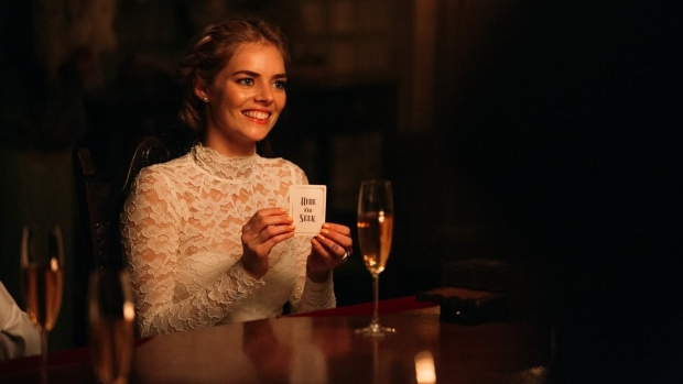 Grace, played by Samara Weaving, holds a hide and seek card in the upcoming film 'Ready or Not.' (Ready or Not/ Fox Searchlight Pictures/ Facebook)