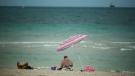 Two sun bathers enjoy the warm sunny breezes on Fort Lauderdale, Fla. beach, Wednesday, April 16, 2014. (AP Photo/J Pat Carter)